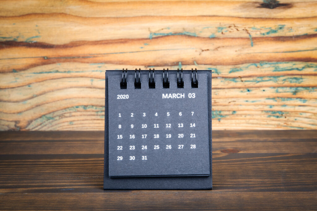 2020 March . Black paper calendar on a wooden table. Time planning, day counting and holidays